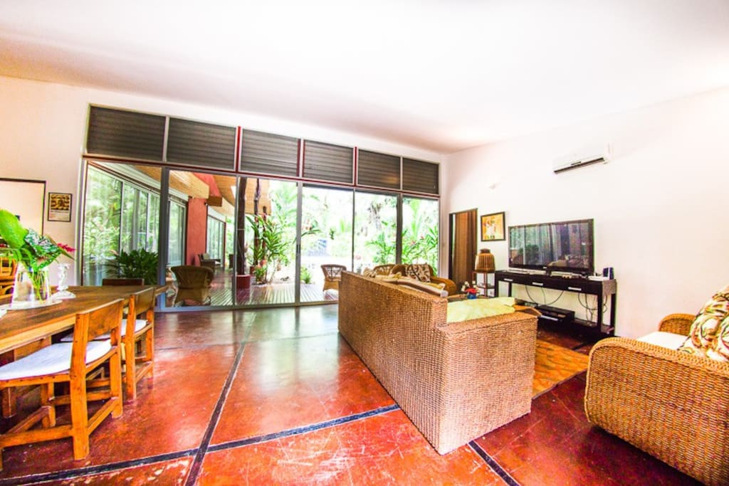Huge sliding glass windows and living area with polished cement floors, 50 inch big screen with cable, blu ray DVD, Roku that includes. High Speed Wireless Internet  netflix and streaming music.