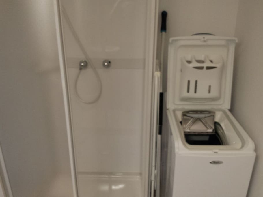 Shower cabin an washing machine