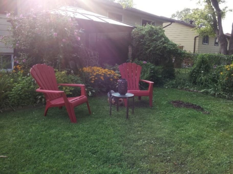 Feel free to sit in the back yard and enjoy the garden.