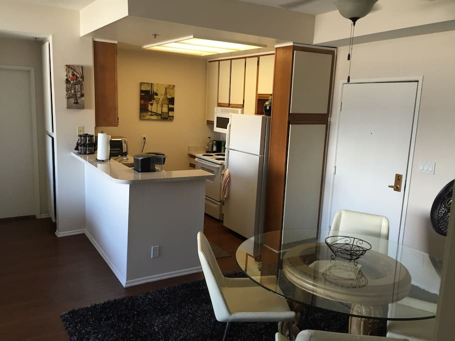 Fully furnished kitchen with all cooking supplies.
