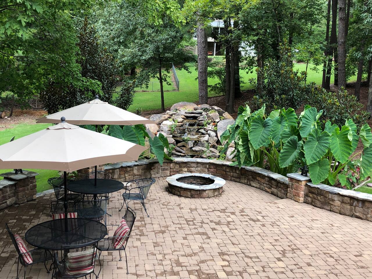 Our outdoor oasis is a great place to enjoy getting away from the hustle and bustle of every day life and listen to the peaceful sounds of the waterfall.  Eat your meals here, bring your work outside with strong WIFI, or just visit with guests.