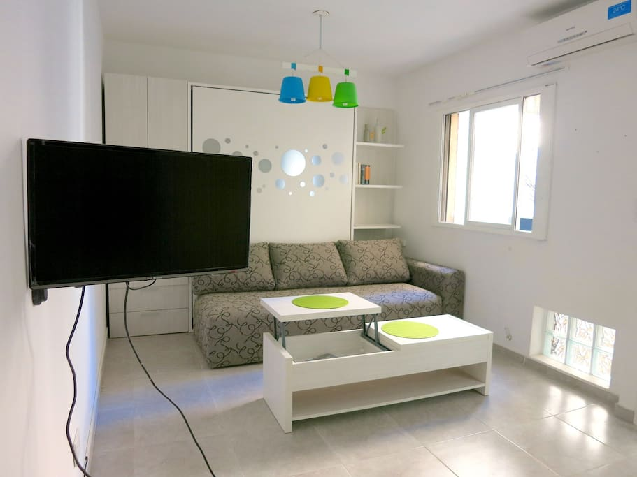 The smart TV can be watched either from the living room or from the dining table