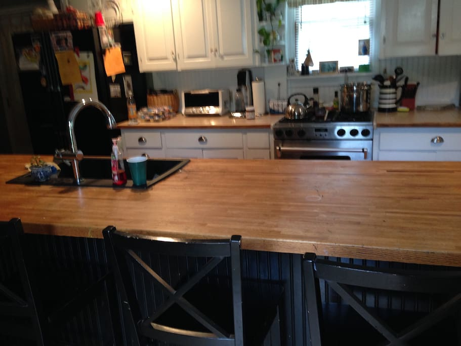 8 foot butcher block island is a perfect gathering spot