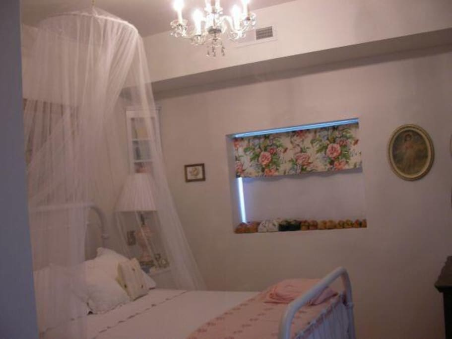 The Pink Room, double antique iron bed looking out thru double French doors to a killer mountain view!