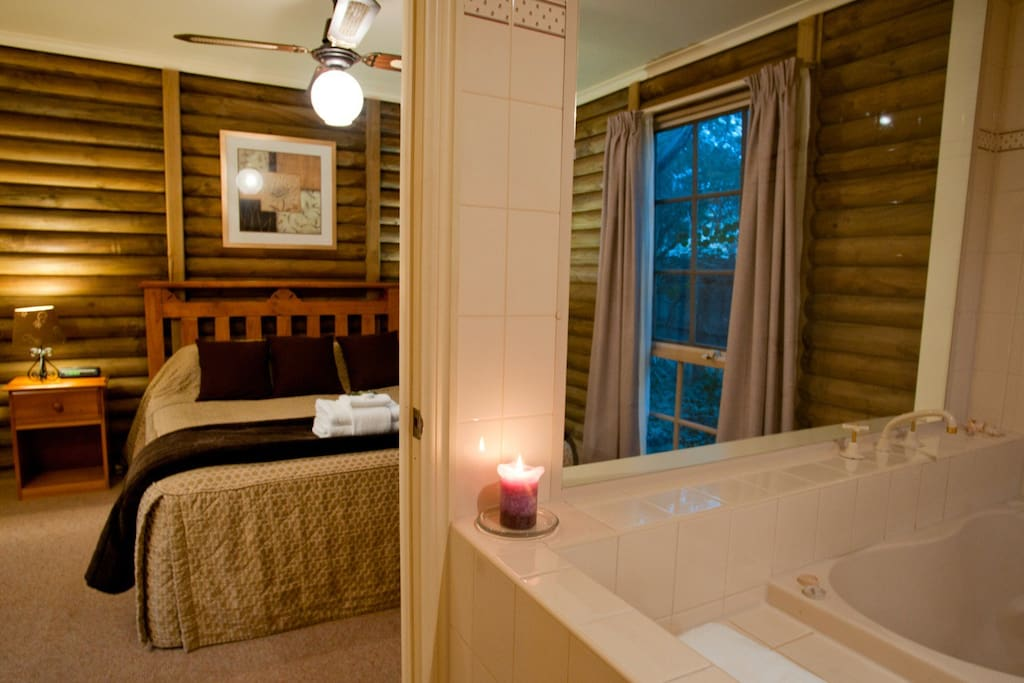 Master bedroom with queen sized bed. Bathroom with two person spa bath.