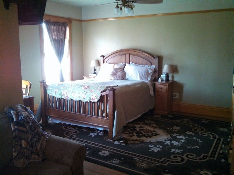 The Rigby Suite is the larger of the two suites, and sleeps two on its queen bed.  In winter, there are warm, fuzzy sheets and an electric blanket.  In spring, lighter-weight linens and a featherbed.  The 1899 House is also centrally heated and air conditioned.