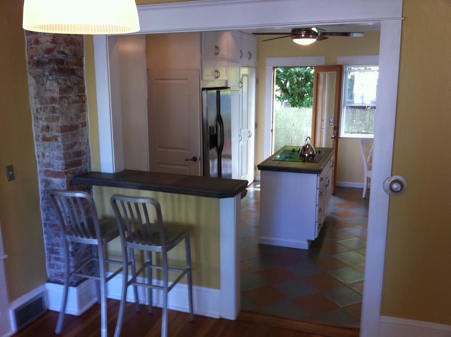 Updated kitchen with stainless steel appliances, dishwasher, microwave, cooktop island, washer/dryer.