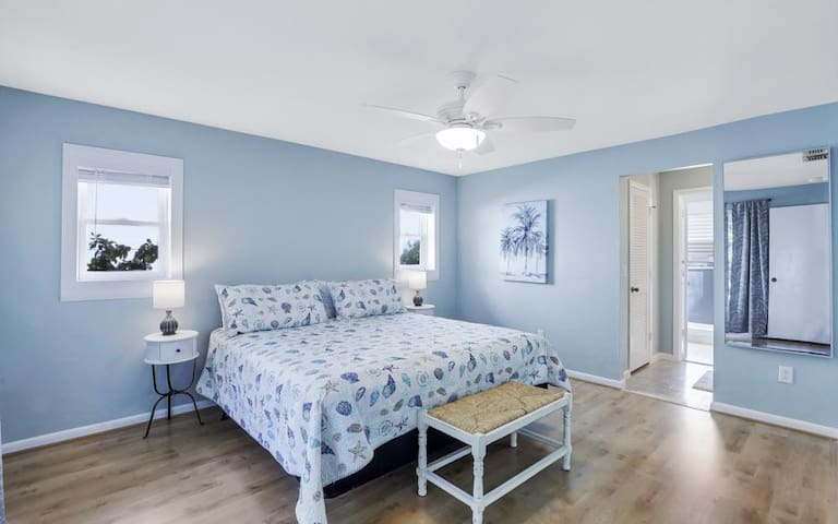 Master Bedroom (King Sized Bed) with French Doors to lanai along with dual vanity bath, large shower and walk in closet