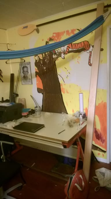 Desk and Calvin and Hobbes mural