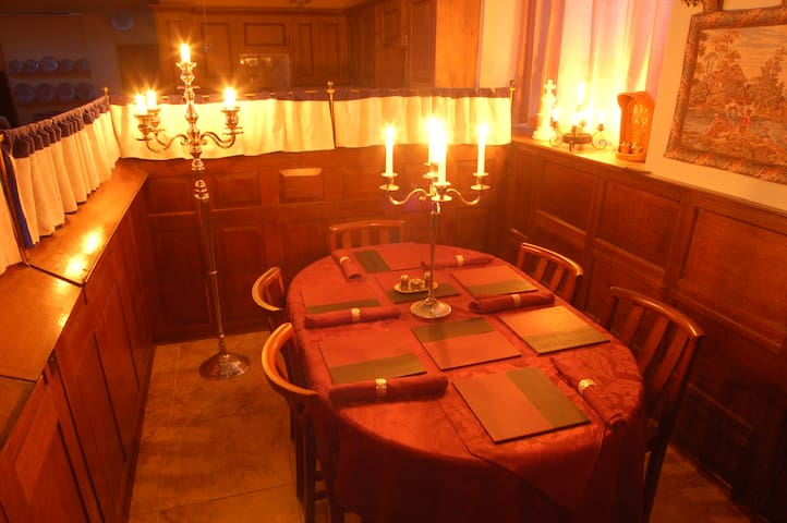 Candlelit dining in the Squires Pew.