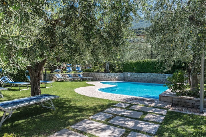 """Holiday Apartment """"Appartamento Casa Stefi N2"""" close to lake Garda with Wi-Fi, Balcony, Garden & Pool; Parking Available, Pets Allowed"""
