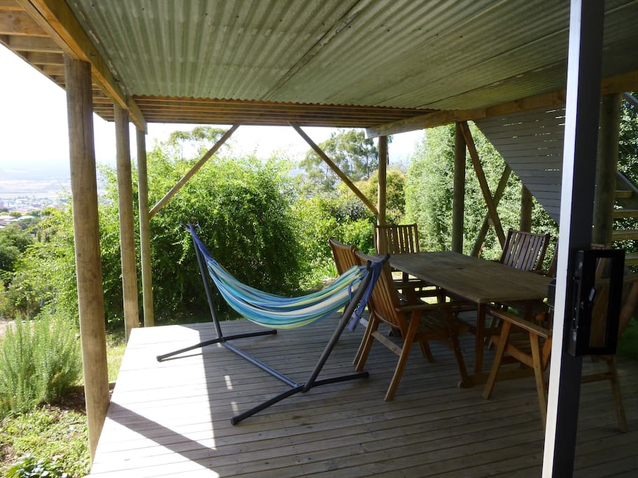 Use of deck, table, chairs and hammock