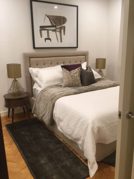 Very comfortable Chiro Contour queen bedroom with  double glazing & lots of robes in this Melbourne CBD serviced apartment