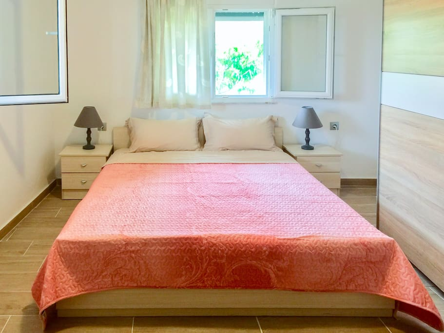 The king size bed in Bedroom with a very comfy matres. In here you will wake up by the sounds of birds, every single morning.