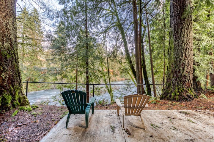 Historic dog-friendly riverfront cabin with woodstove near hiking and fishing