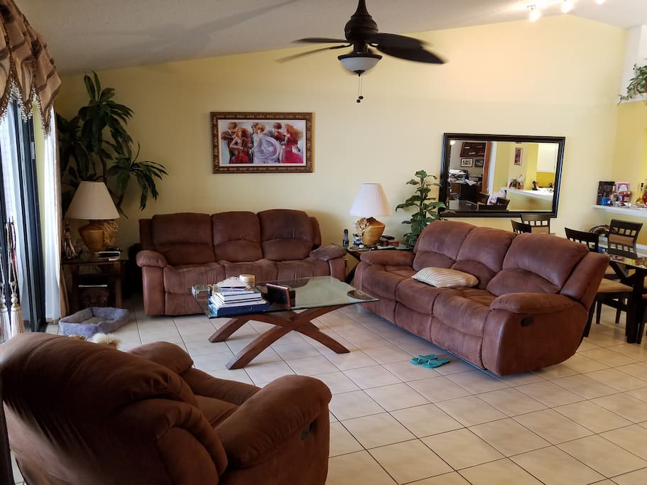 Spacious Living & Dining Areas with Vaulted Ceilings