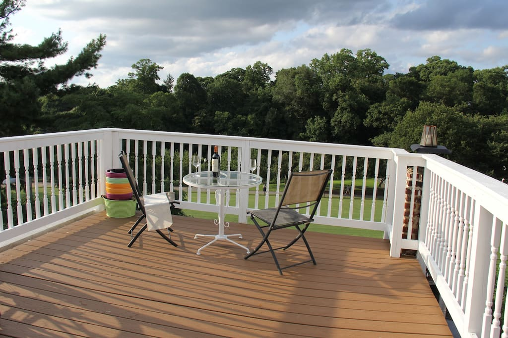 The apartment comes with a private deck overlooking a lush neighborhood park