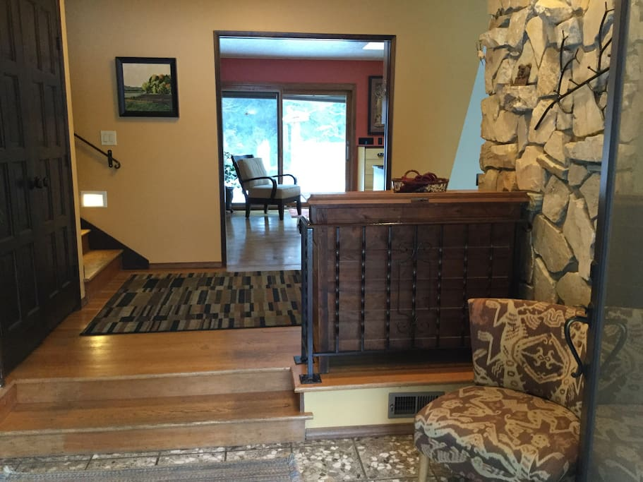 Split level entry: 8 steps up from street level; 2 up to landing; 2 up to hallway leading to bedrooms; 2 down into living room.
