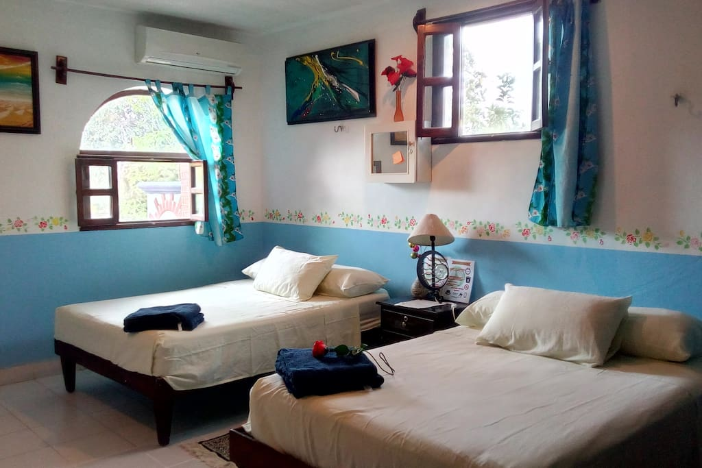 this is room 3  with two doble beds,is spacious and very cool from inside. with lots of windows.