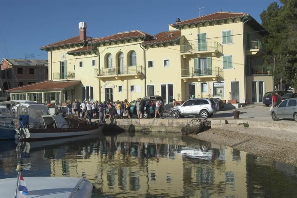 our boat in front of the hotel Televrin in the port at which the daily selling fresh fish , and if you are our guests , you can buy it directly from us in the house , and we can and save , if desired