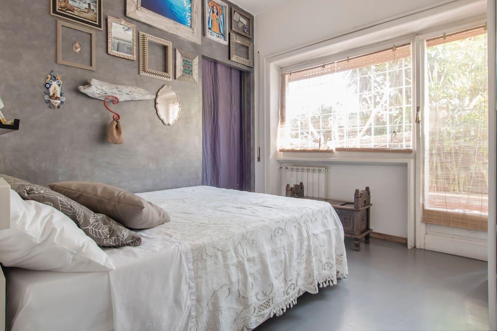 The bedroom overlooking the terrace