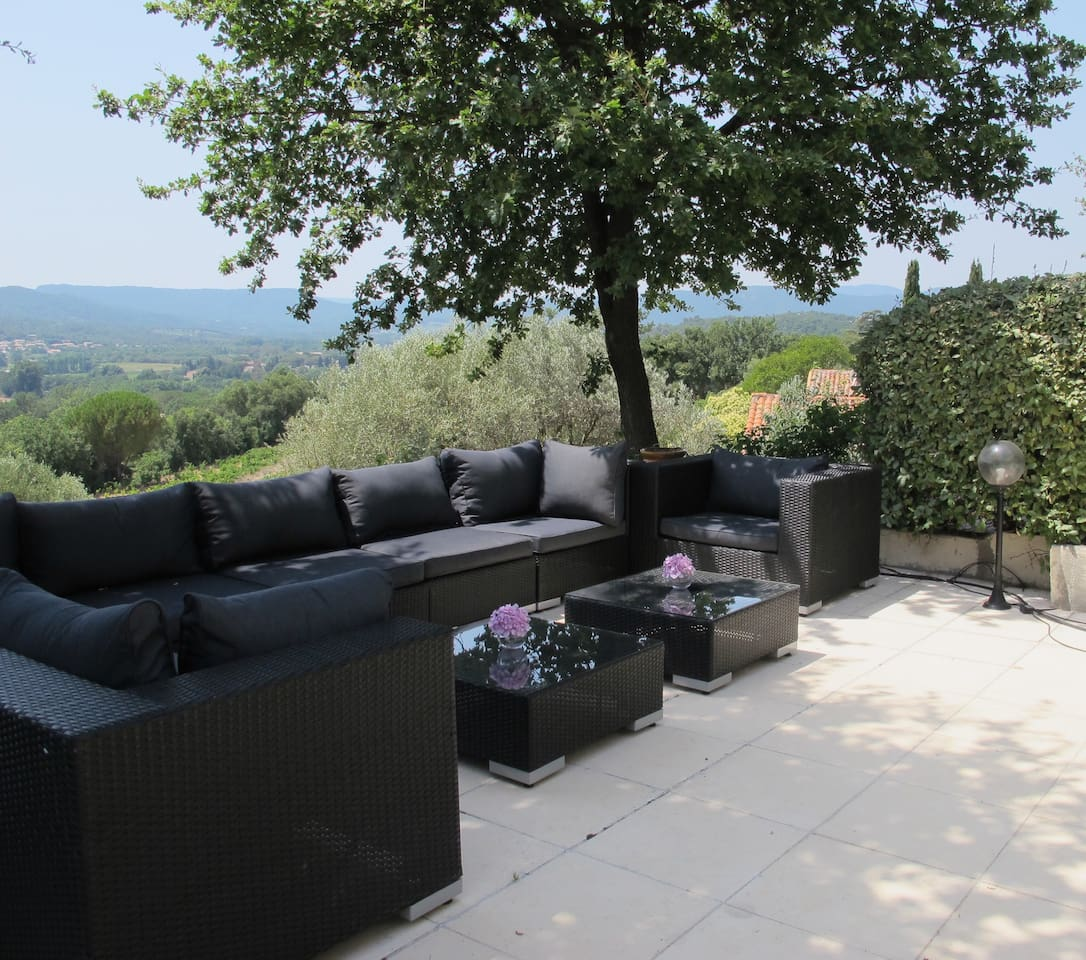 Relax on the terrace with a glass of delicious local wine