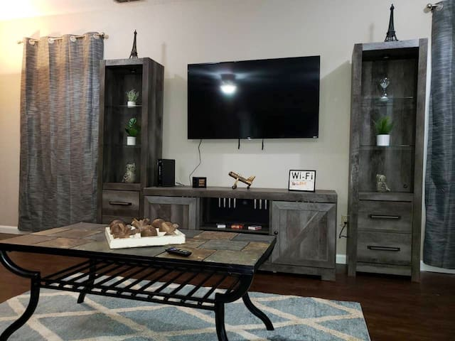 "Family room - sit back, relax and enjoy one of the two 55"" smart TVs (other is located in living room)  with all your favorite apps! Hulu, Netflix's, Pandora and much more! Plus Spectrum tv with over 250 channels!!!   WiFi Included**"