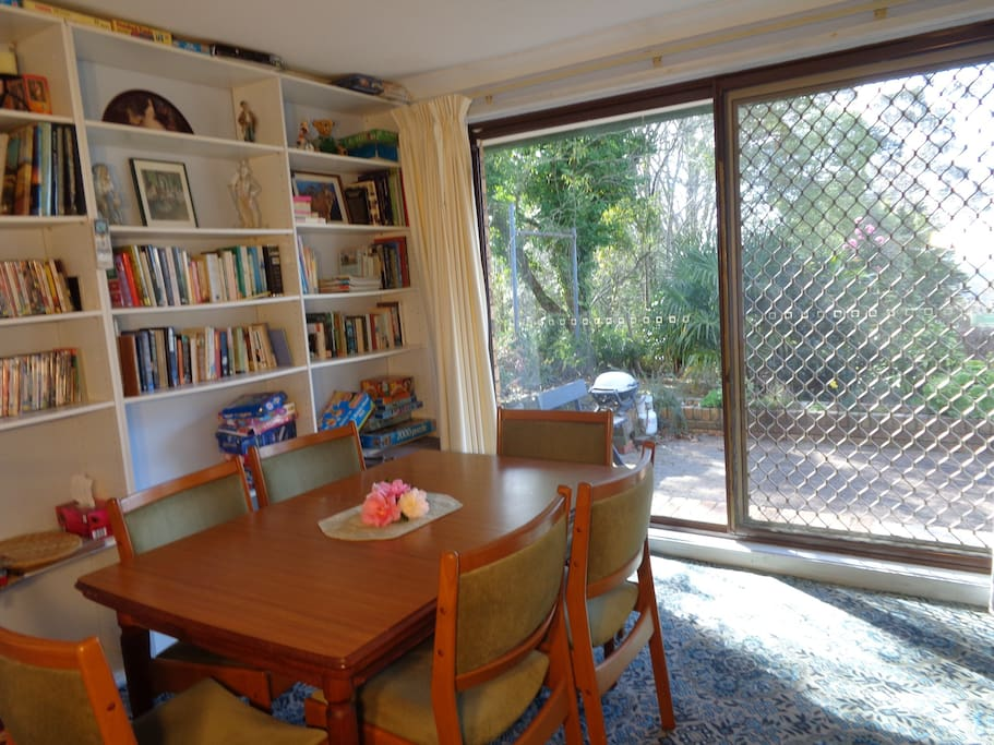 Dining room out looks onto garden with mountains vistas