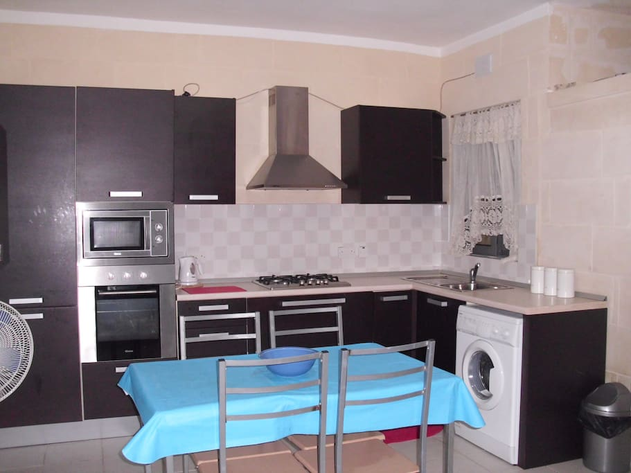kitchen with microwave and washing machine