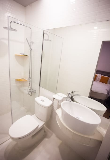 Clean, white bathrooms with new TOTO rain showers