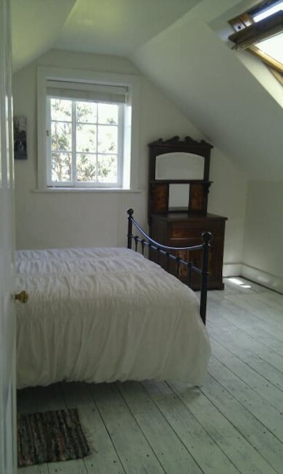 The upstairs dormer bedroom with a queen bed.