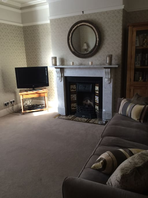 The main feature of the spacious and welcoming sitting room is the original marble Victorian fireplace