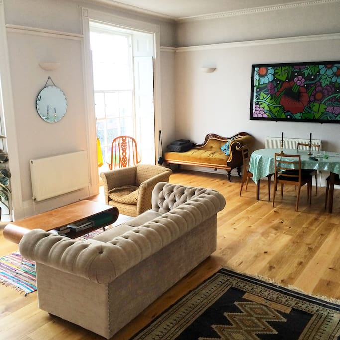 Living Room with two floor to ceiling sash windows, overlooking the harbour