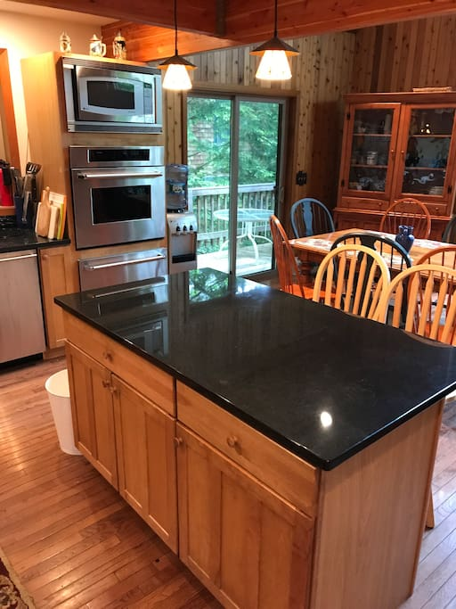 New granite island and fully stocked kitchen.