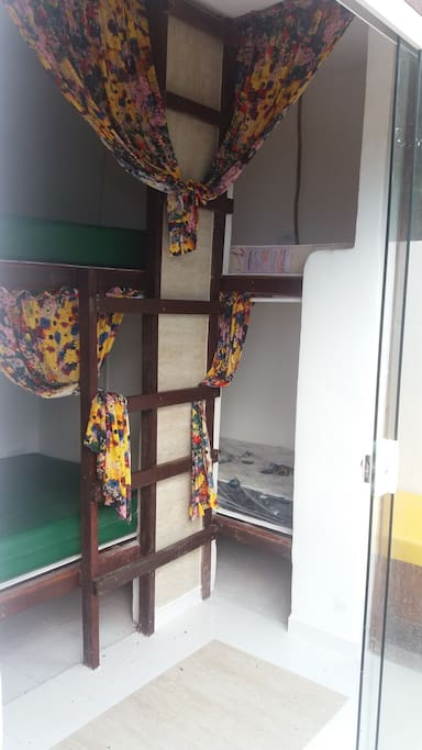 6 dorm beds with enclosed sleeping compartments with curtains for privacy