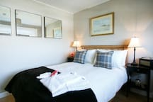 Inis Deala, my favourite room, is cute with a 4.5 foot double bed and a private bathroom [not an ensuite] so we provide you with robes and complimentary slippers.