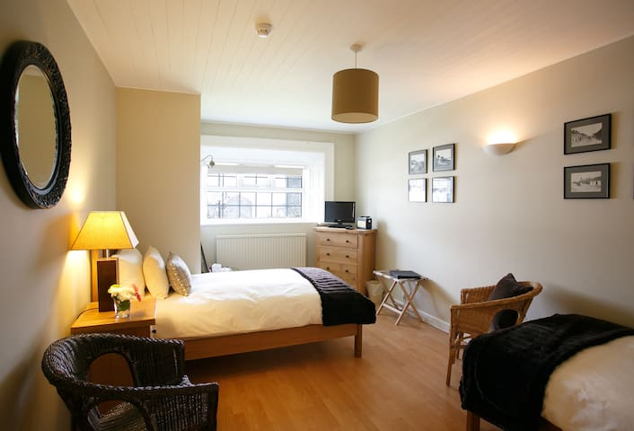 Inis Mor, our twin room, which can also be turned into a super-king double. the room has a sea view and huge ensuite shower and bathroom.