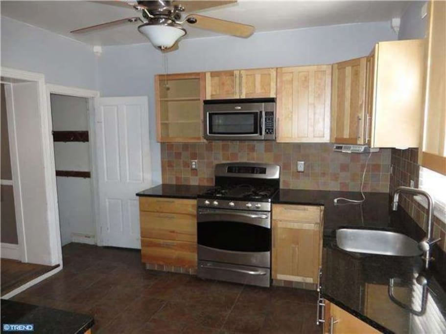 Large kitchen with brand new appliances
