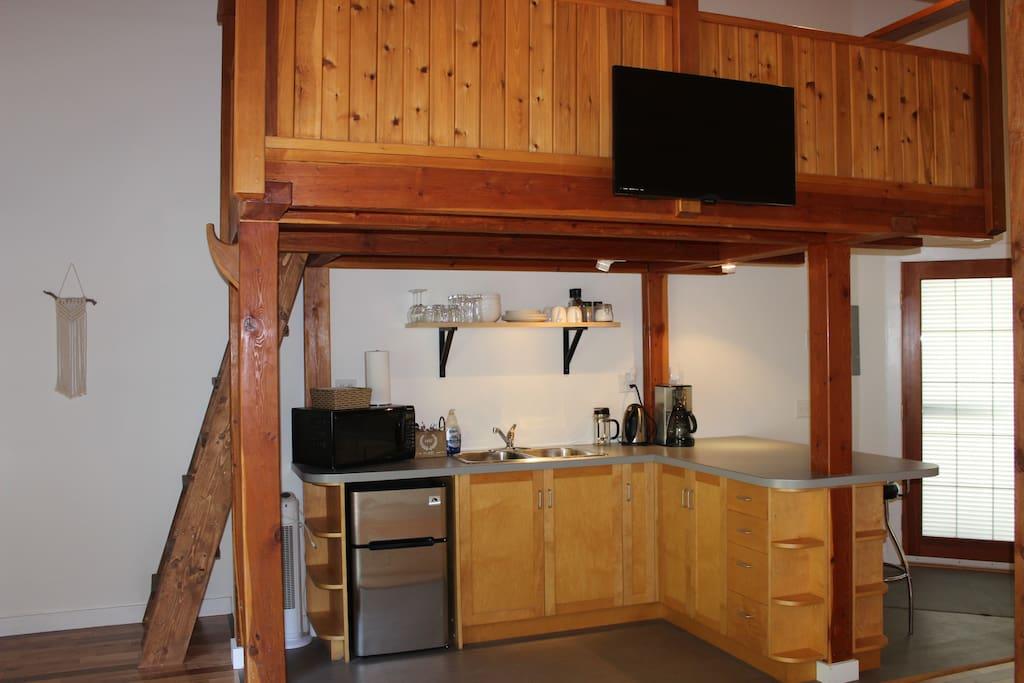 Smart TV mounted to the loft. We provide Netflix.