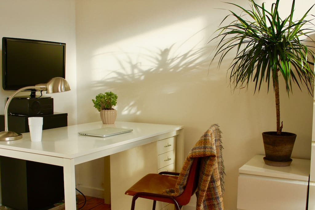 The desk in the bedroom where you can work