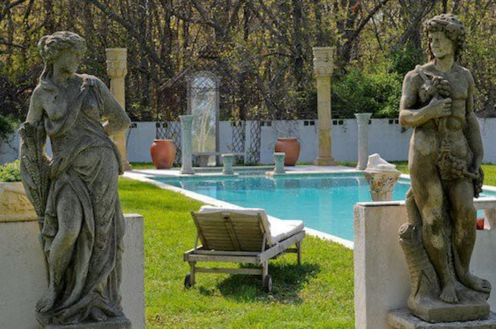 a luxurious ancient style heated pool with roses ,jasmine and lilies