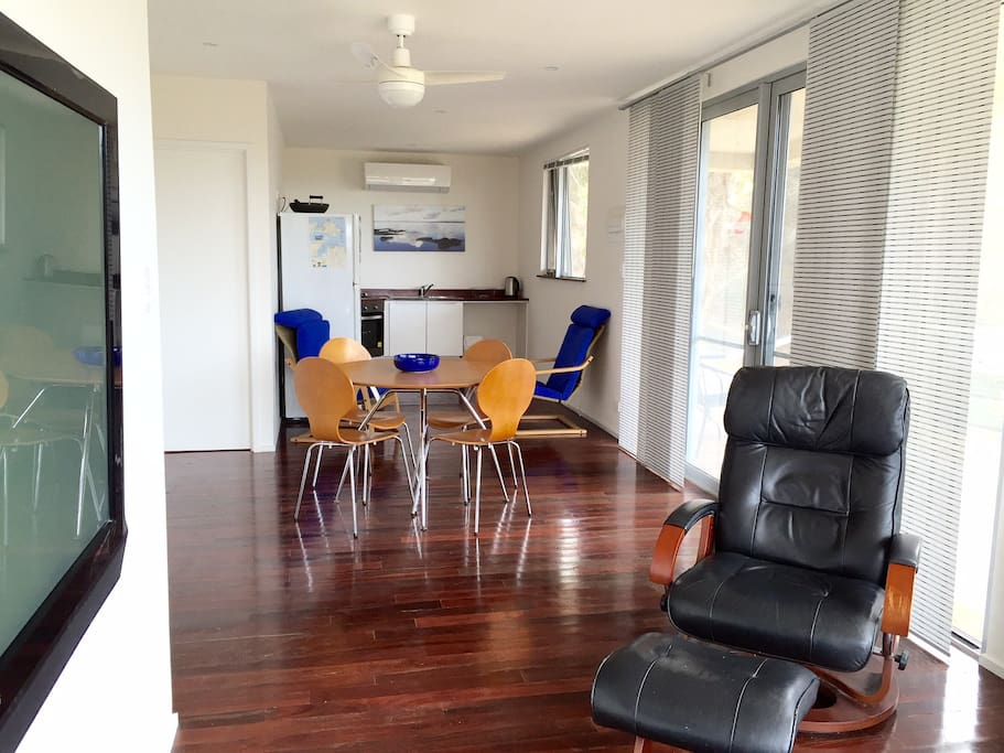 A large kitchen and separate dine, plus a man chair and 2 comfy lounges to relax after then 2 bedrooms and a jarrah deck just for you.