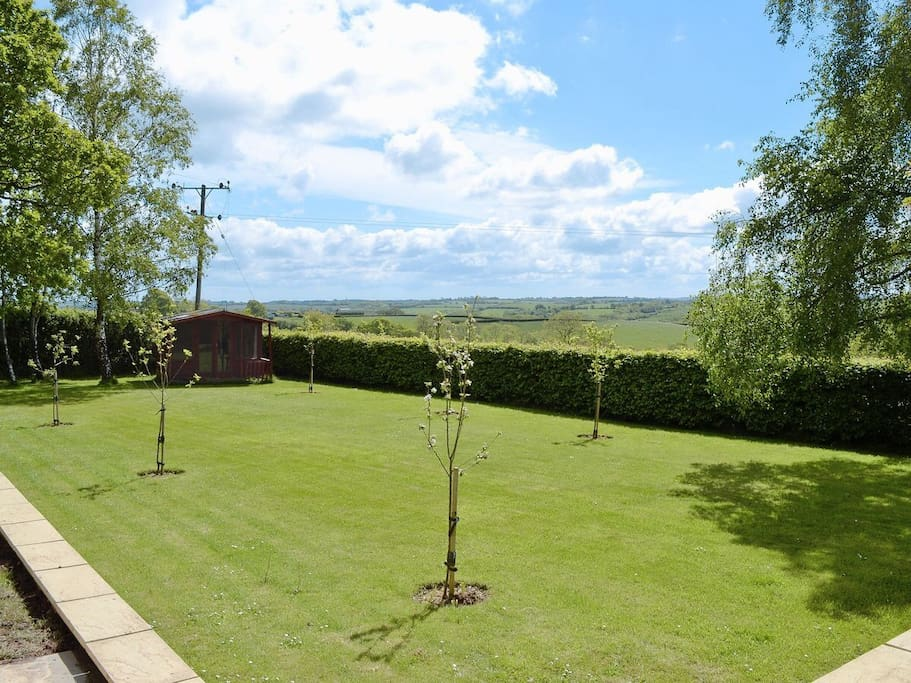 Part of the large garden, ideal for dogs. Enjoy the views.