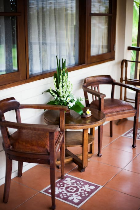 Coffee table and chairs at the terrace with pool & rice field views