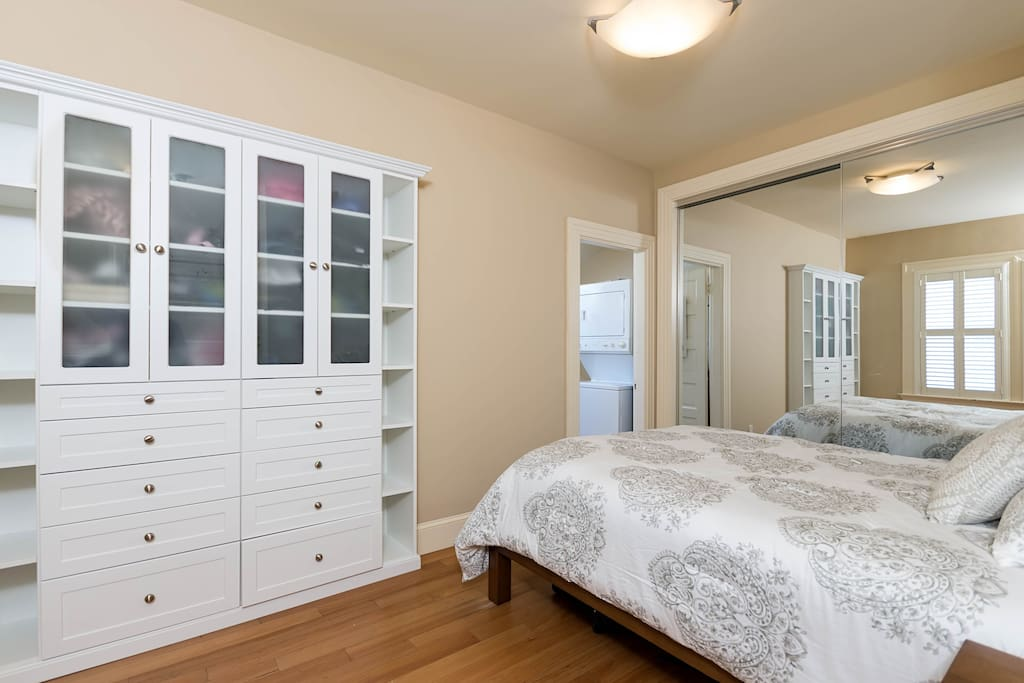 Bright bedroom, also with built in shelves, and a queen-sized bed