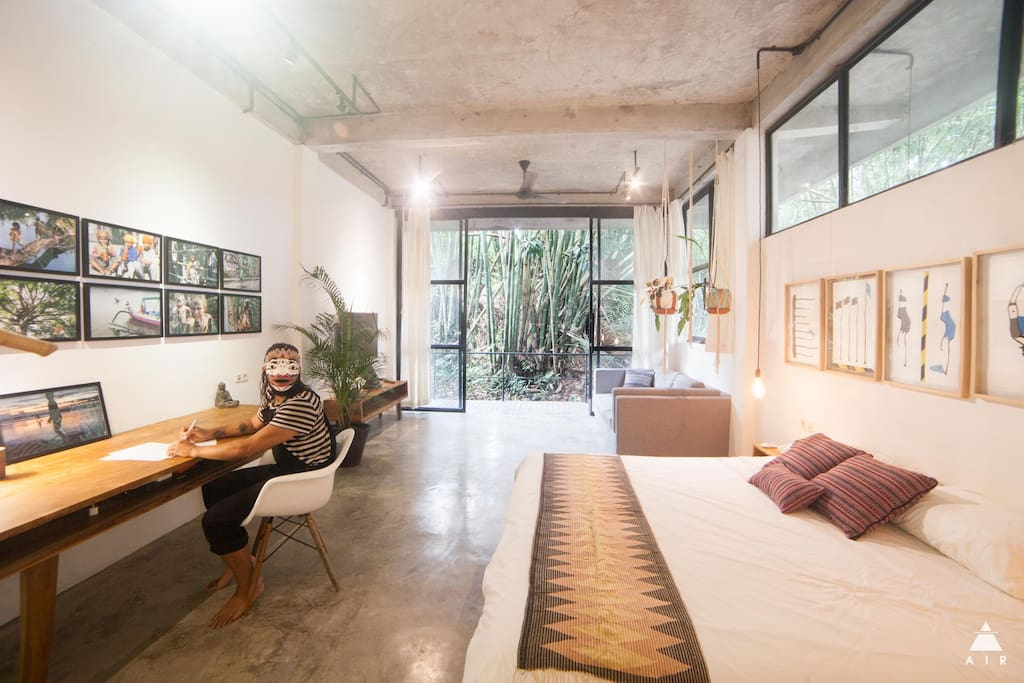 Extra large room with river view, karge working desk and media center with selected films and documentaries about art, design and culture