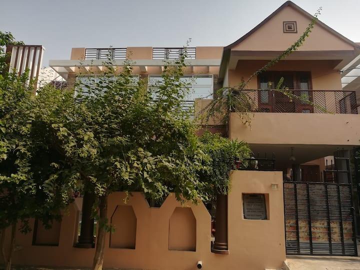 Comfortable 2 BHK, Modern amenities, Green area