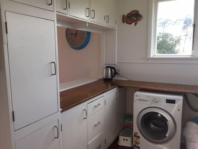 Kitchen with washing machine.