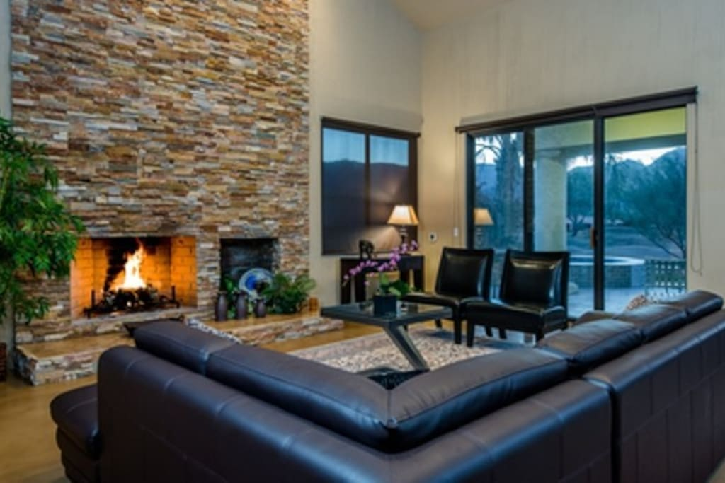 Family room with wood burning fireplace and seating for eight.