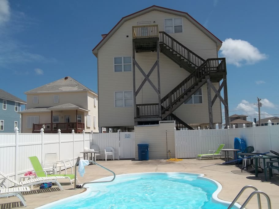 Back of house. Separate entrance to apartment or use inside stairs. Private pool!